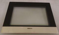 Дверная панель дверки духовки плиты Беко 210440136