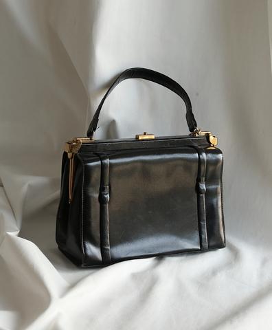 Черная винтажная сумка с ручкой
