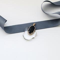 Медальон из прозрачного пластика с чёрным фианитом  оптом и в розницу