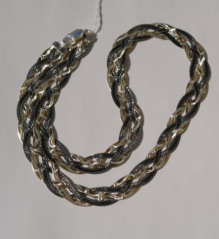 Коса четырехцветная с позолотой и чернением(серебряная цепочка)