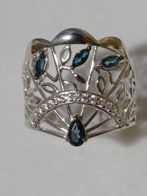 Веер с лондон топазом(кольцо из серебра).