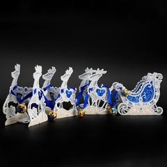 Упряжка оленей с санями в синем цвете