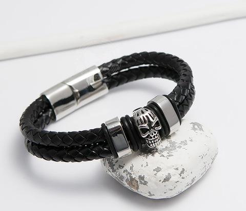 Мужской браслет из шнуров со стальным черепом (20 см)