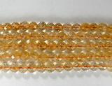 Нить бусин из цитрина, фигурные, 6 мм (шар, граненые)