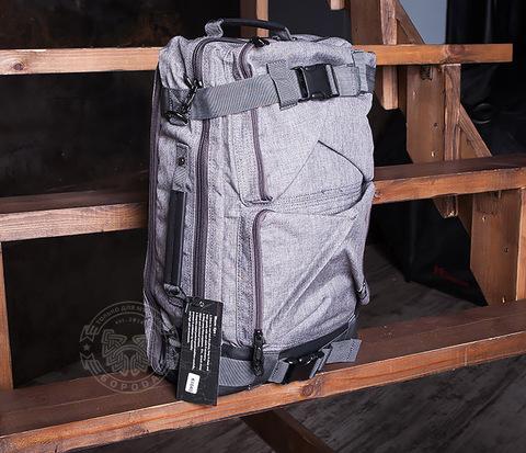 Вместительный мужской рюкзак трансформер сумка для города из ткани