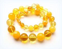 бусы мз янтарных шаров жёлтого цвета