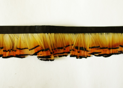 Тесьма  из перьев золотого фазана  около 4 см.