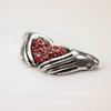 """Коннектор """"Сердце в ладонях"""" с красными фианитами 34х17 мм (цвет - античное серебро)"""