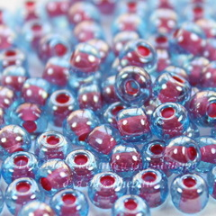 61398 Бисер 5/0 Preciosa прозрачный глянцевый голубой с красным центром