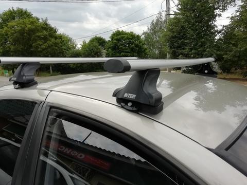 Багажник на крышу Nissan Almera N15 седан 1995-2000 за дверной проем аэродинамические  дуги 120 см.