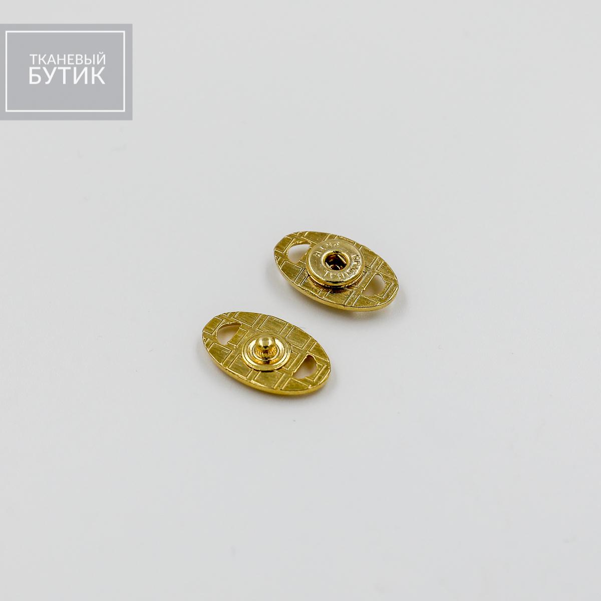 Овальная кнопка из металла с геометрическим декором