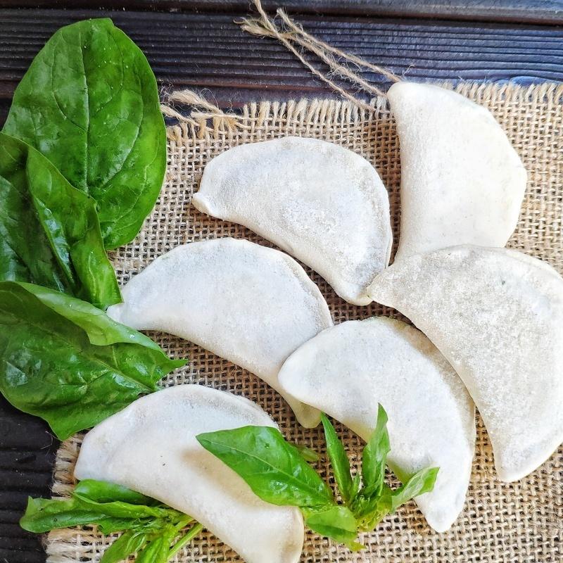 Фотография Вареники с со шпинатом и адыгейским сыром 500 г /тонкое тесто/ купить в магазине Афлора