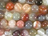 Нить бусин из агата Ботсвана пестрого, шар гладкий 12мм