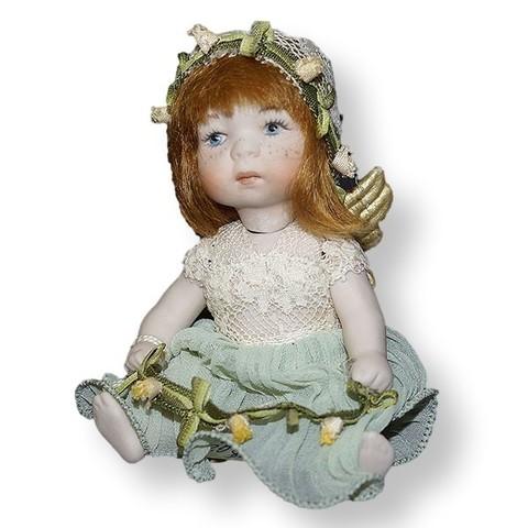 Кукла фарфоровая коллекционная Marigio Angelo в зеленом