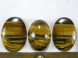 Комплект кабошонов тигрового глаза 30x22x4 мм - 2 шт., 28x20x9 мм - 1 шт.