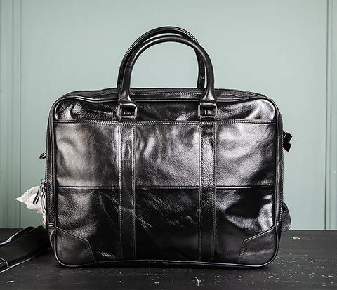 Мужской кожаный деловой портфель черного цвета