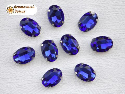 Камень овал в цапах 10*14 мм синий