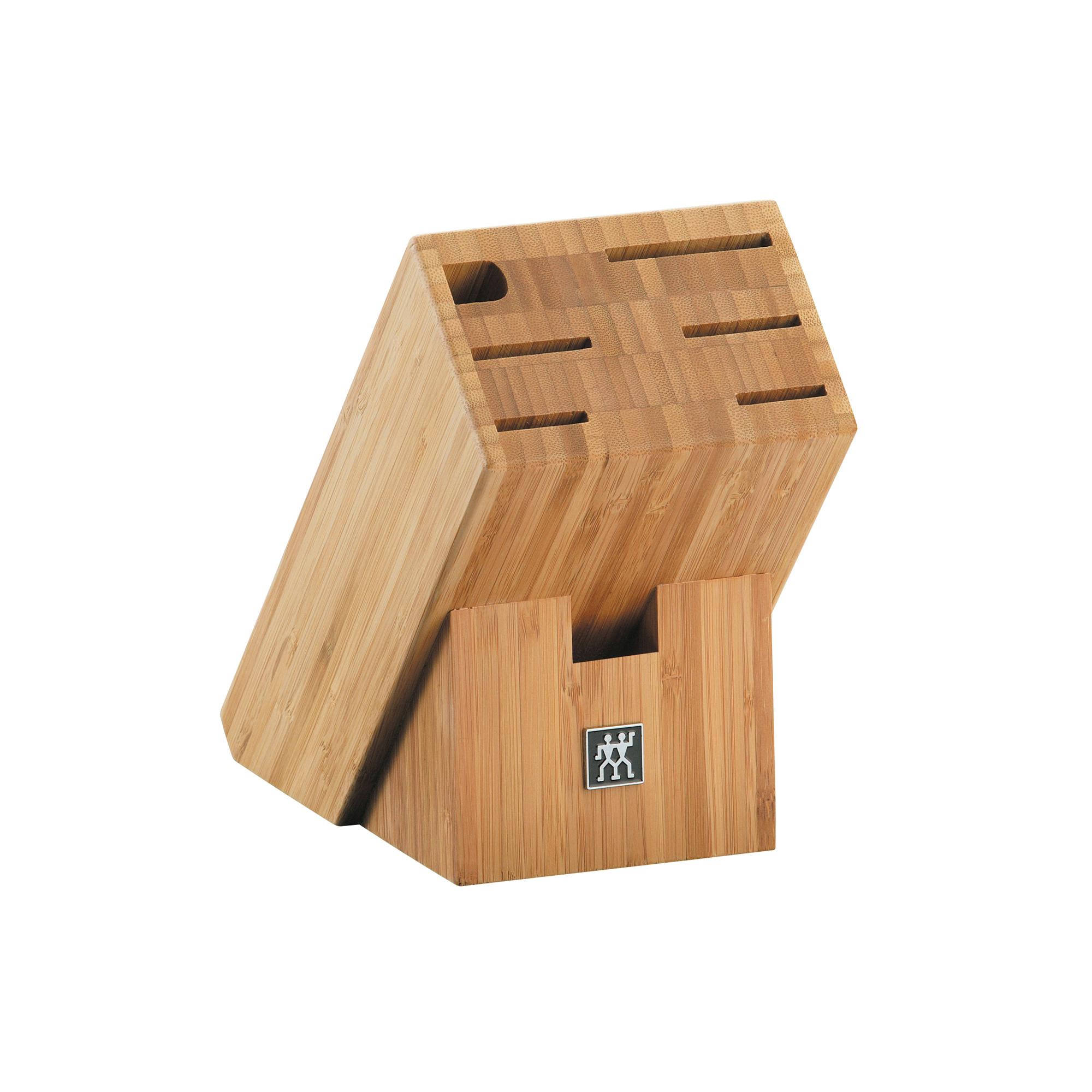 Подставка для ножей из бамбука Zwilling 35042-400Деревянные подставки<br>Подставка для ножей из бамбука Zwilling 35042-400<br><br>Изготовлена: из бамбука. Имеет 7 отделений. Изделия из бамбука обладают высокой стойкостью к механическим повреждениям и влаге.<br>Применение: для хранения ножей.<br>Уход: периодически протирайте влажной тканью.<br>Внимание: Не размещайте подставку вблизи источников тепла, Не оставлять в воде, не мыть в посудомоечной машине . Использовать только по назначению! Хранить в недоступном для детей месте.<br>