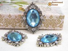 Камни овалы в серебряном ромбовом обрамлении голубые