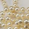 5810 Хрустальный жемчуг Сваровски Crystal Cream круглый 12 мм