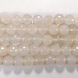 Нить бусин из агата белого, фигурные, 10 мм (шар, граненые)