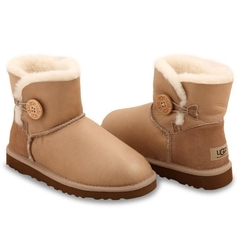 /collection/bailey-button-mini/product/ugg-bailey-button-mini-soft-gold