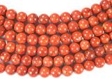 Нить бусин из коралла яблочного, облагороженного, шар гладкий 10 мм