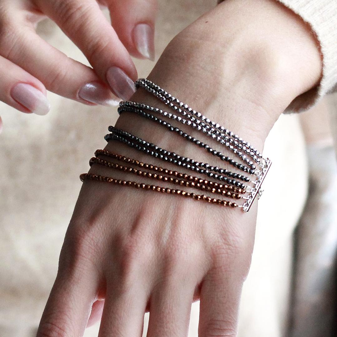 Многорядный браслет Silver&Stones из черного, серебристого и золотистого гематита и серебра Strelkovskikh