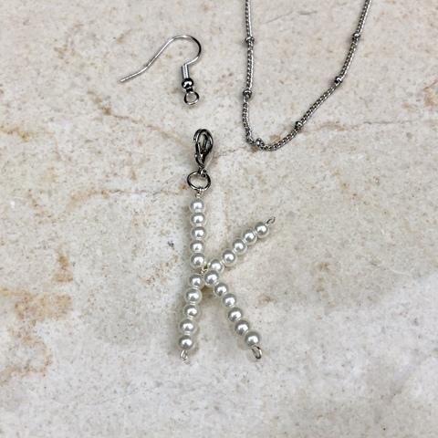 Подвеска Буква K с замочком серебряного цвета