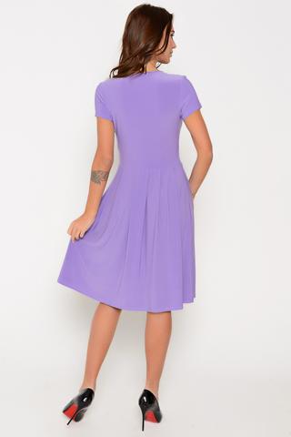 Эффектное платье приталенного силуэта. Талия завышена. V-образный вырез с запахом и мягкой драпировкой. Юбка пышная со складками. Рукав короткий. Отличный летний вариант.
