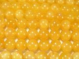 Нить бусин из кальцита желтого, шар гладкий 12мм