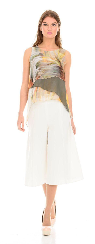 Блуза Г553-150 - Летняя многослойная блуза уместна на деловом и романтичном свидании. Удлиненная спинка и свободный крой скрывают возможные несовершенства фигуры, продуманная комбинация тканей удлиняет корпус и визуально стройнит. Ткань состоит из мягкой и приятной итальянской вискозы, что обеспечивает комфорт в блузе даже в жаркий день.