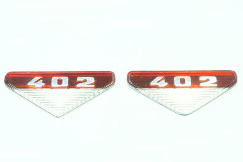 Вставка эмблемы на крыло Москвич 402