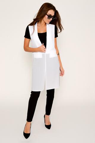 Ультра модный удлиненный жилет с клапанами. Низ жилета выполнен из креп - шифона. По бокам разрезы. (Длина: 93 см во всех размерах)