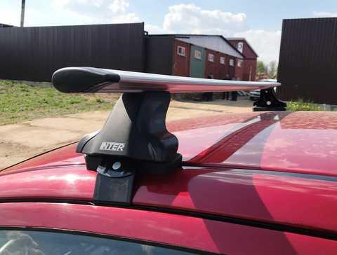Багажник на крышу Nissan Almera N15 седан 1995-2000 за дверной проем крыловидные дуги 120 см.