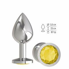 Серебристая средняя пробка с желтым кристаллом - 8,5 см.