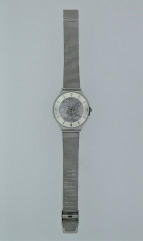 Часы с циферблатом из метеорита Муонионалуста