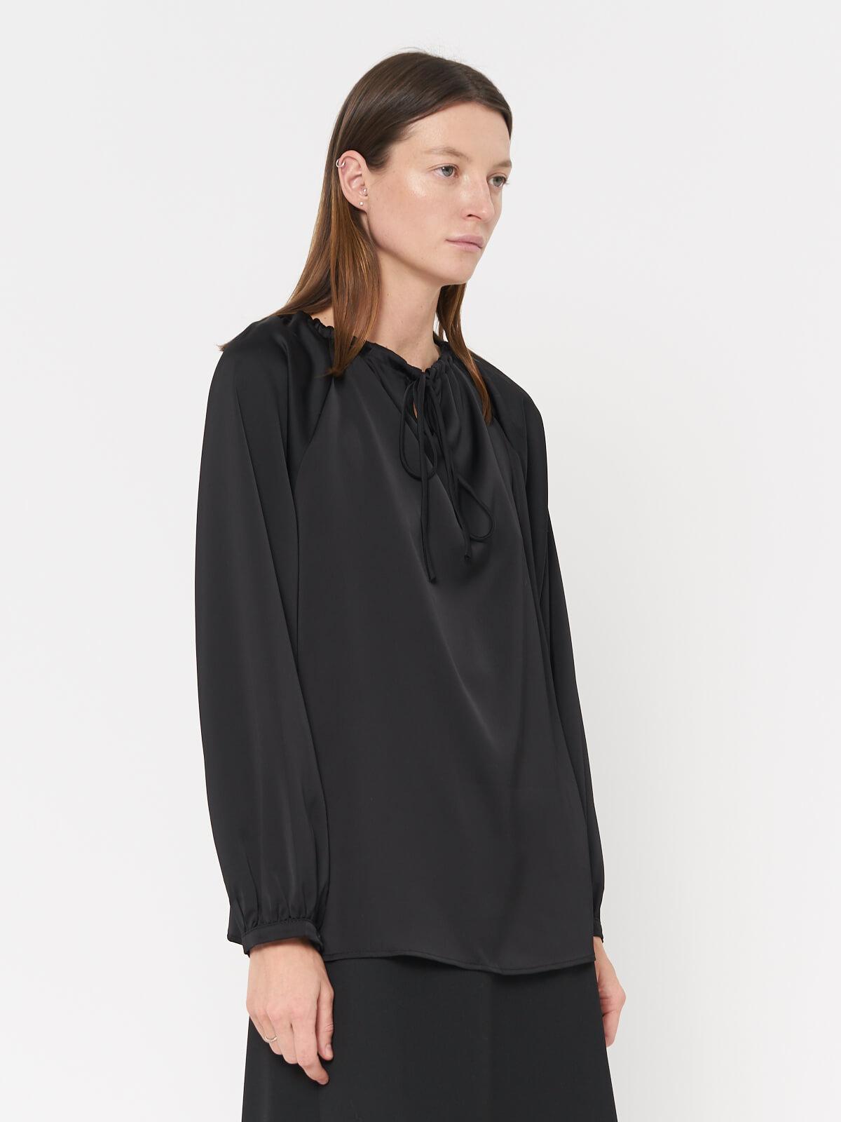 Блуза с затяжкой