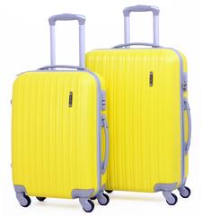 Чемодан Ananda A03 желтый L. Пластиковый на четырех колесах.