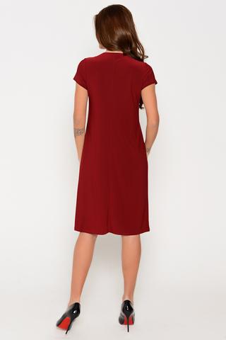 """Очаровательное платье свободного кроя из мягкого трикотажа. Рукав короткий. Ворот """"качели"""". По переду оригинальная драпировка из складок. Отличный вариант для изысканной леди!"""