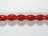 Бусина из коралла красного, облагороженного, фигурная, 6x9 мм (овал, гладкая)