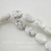 Бусина Говлит, овальная плоская, цвет - белый, 12х8 мм, нить