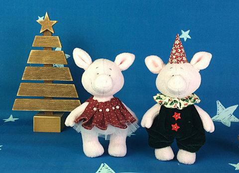 Пара свинок Мія та Грег