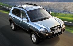Защита фар для Hyundai Tucson 2005-2010 карбон, 2 части, EGR (214040)