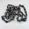 Бусина Обсидиан Снежный, крошка, цвет - черный с белыми крапинками, 5-8 мм, нить 83-86 см