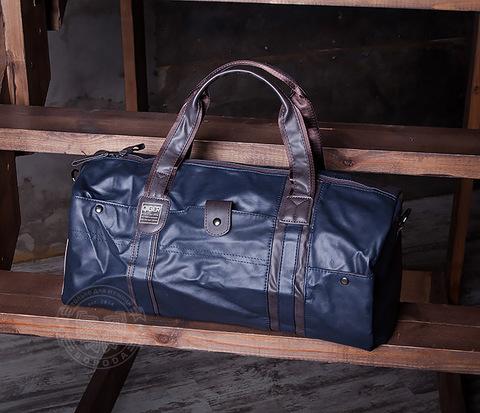 Вместительная мужская сумка из кожи синего цвета