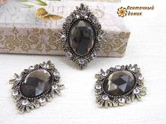 Камни овалы в серебряном ромбовом обрамлении серо-коричневые