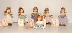 Кукла фарфоровая коллекционная Marigio Angelo в сиреневом