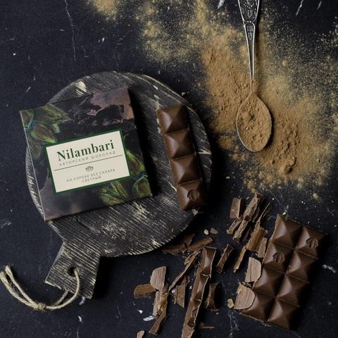 Фотография Шоколад Nilambari на кэробе светлый без сахара, 65 г купить в магазине Афлора
