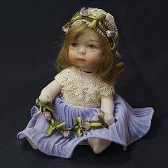 Кукла фарфоровая коллекционная Marigio Angelo в фиолетовом